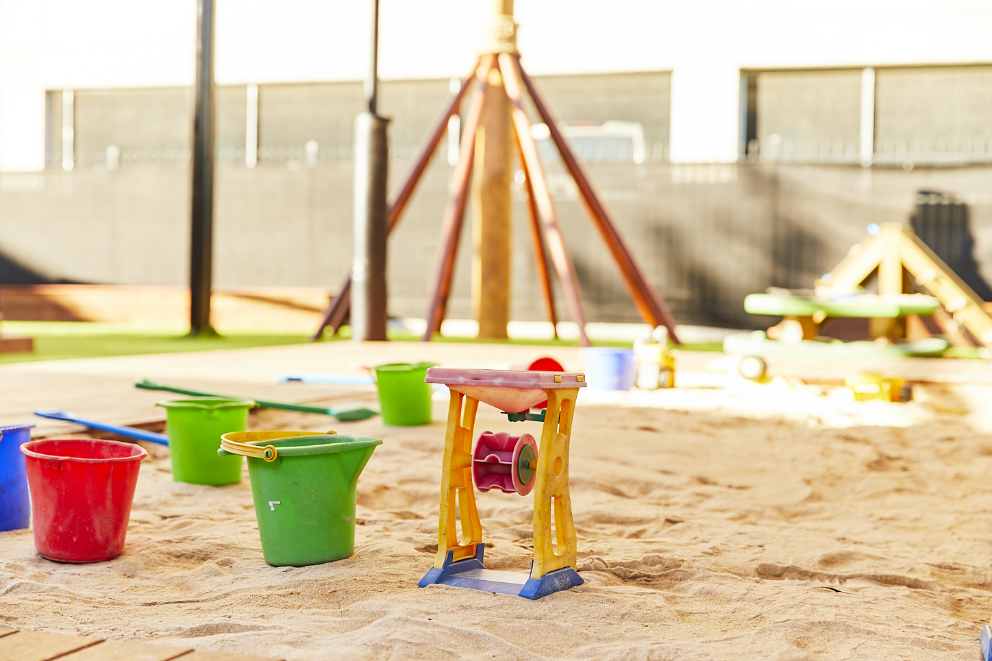 Sand toys in sandpit at child care centre
